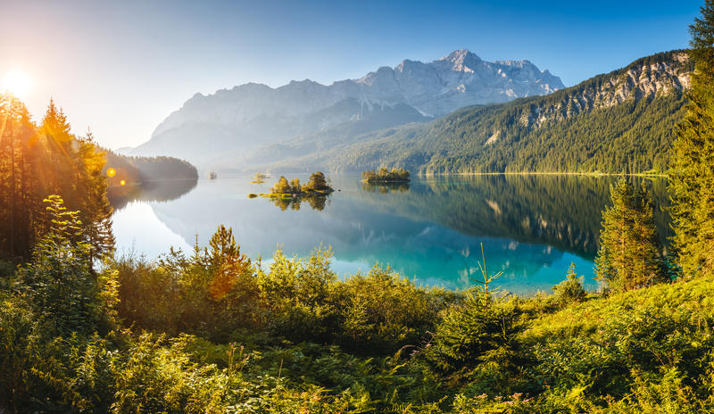 View of the islands and turquoise water at Eibsee Lake at the foot of Mt. Zugspitze. Morning scene. Location famous resort Garmisch-Partenkirchen, Bavarian alp, Europe. Artistic picture. Beauty world.