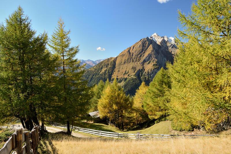 Late fall at Hohe Tauern national park with Ochsenburg rising over Matrei in Osttirol, East Tyrol, Austria