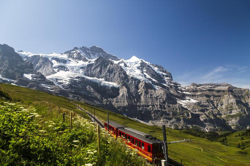 Train of Jungfraubahn running towards Jungfraujoch on sunny day